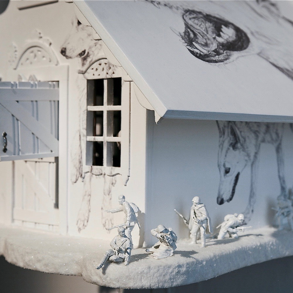 Detail of white wooden cuckoo clock - dolls house - wolf's house with Biro drawings of wolves and toy soldier figures