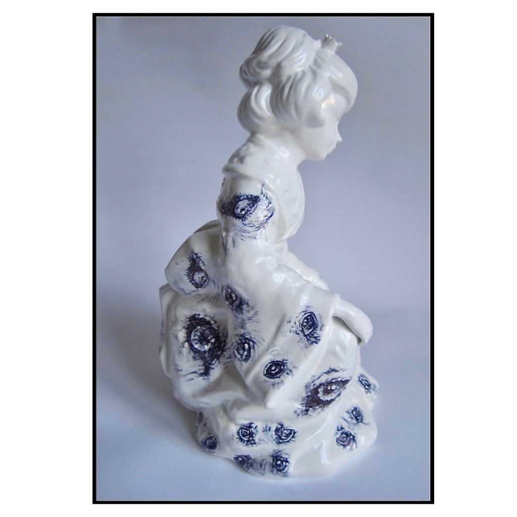 China geisha figurine with Biro drawings of wolves eyes