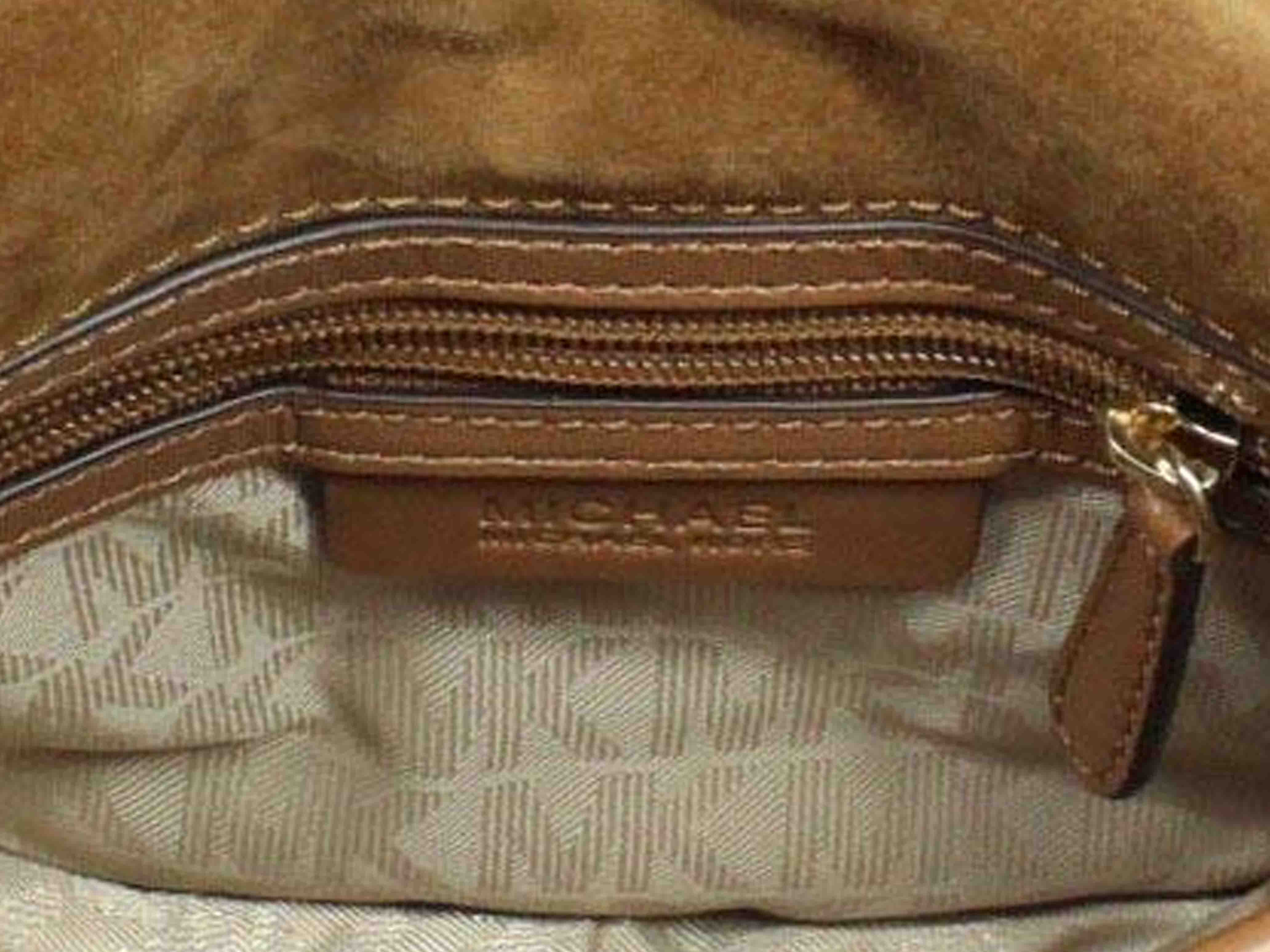 a3df68127ac4 The word Burberry is in the centre on the label with neat stitching all  around. In metal labels