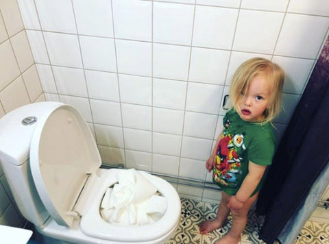 Toddler with Toilet Paper