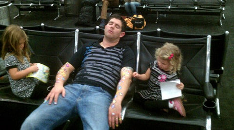 Tired Dad with Daughters and Stickers