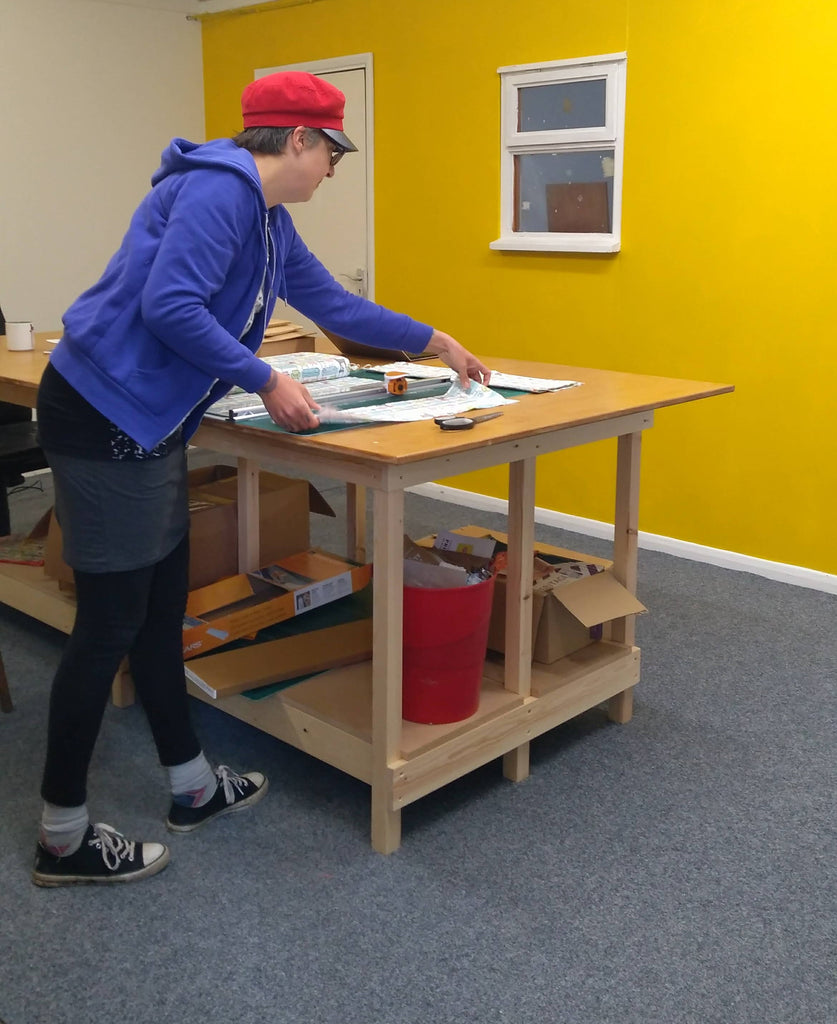 Kate working on the centre table in our bright new workshop
