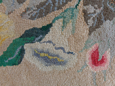 Close up of floral hand hooked rug