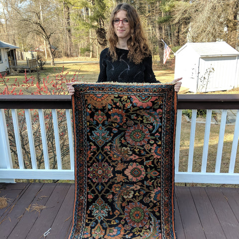 Jess holding Persian rug