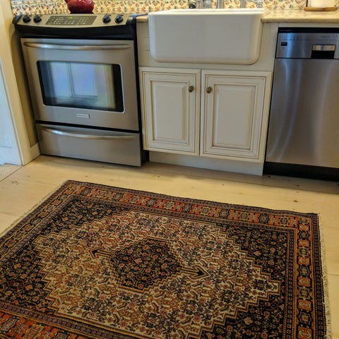 Persian Senneh rug in the Kitchen