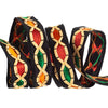 Lozenge shaped applique in vibrant colors on black - by 1/2 yd