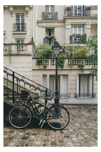 Bike on a cobblestone street in Europe poster - egoamo.co.za