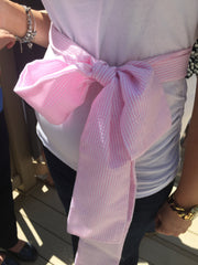 Mommy-to-be with a pink bow around her belly