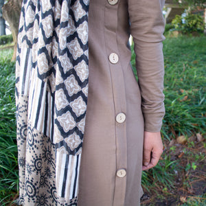 View of button accents on our Long Sleeve Button Dress