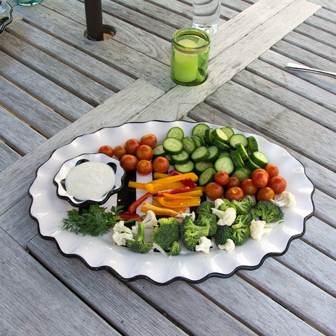 Lifestyle view of our Black Stripe Oval Platter