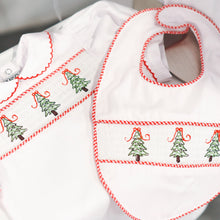 Load image into Gallery viewer, Lifestyle view of our Holiday Christmas Tree Smocked Bib