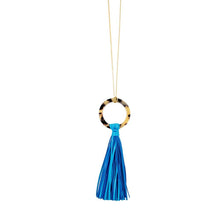 Front view of our Turquoise Blonde Tortoise Tassel Necklace