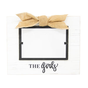 "White frame with burlap bow, black hand lettering says, ""The Girls"""