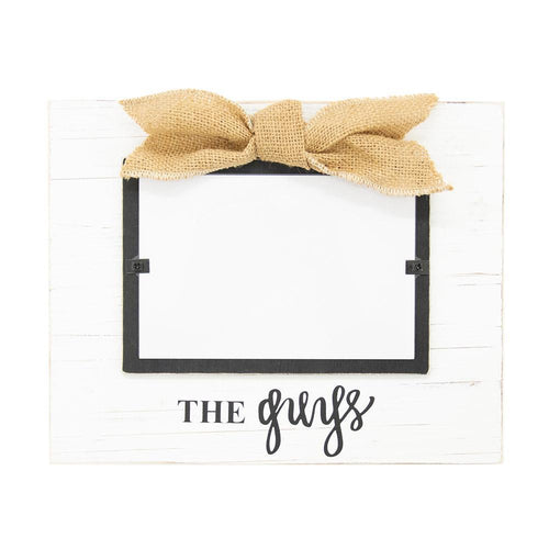 White frame with burlap bow, black hand lettering says,