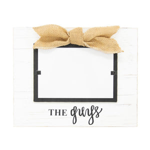 "White frame with burlap bow, black hand lettering says, ""The Guys"""