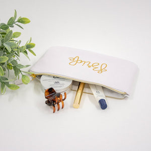 MRS white zippered pouch, hand lettered in gold, with make-up