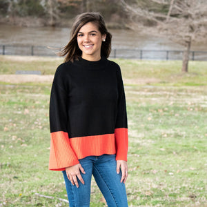 Lifestyle view of our Coral Color Block Sweater