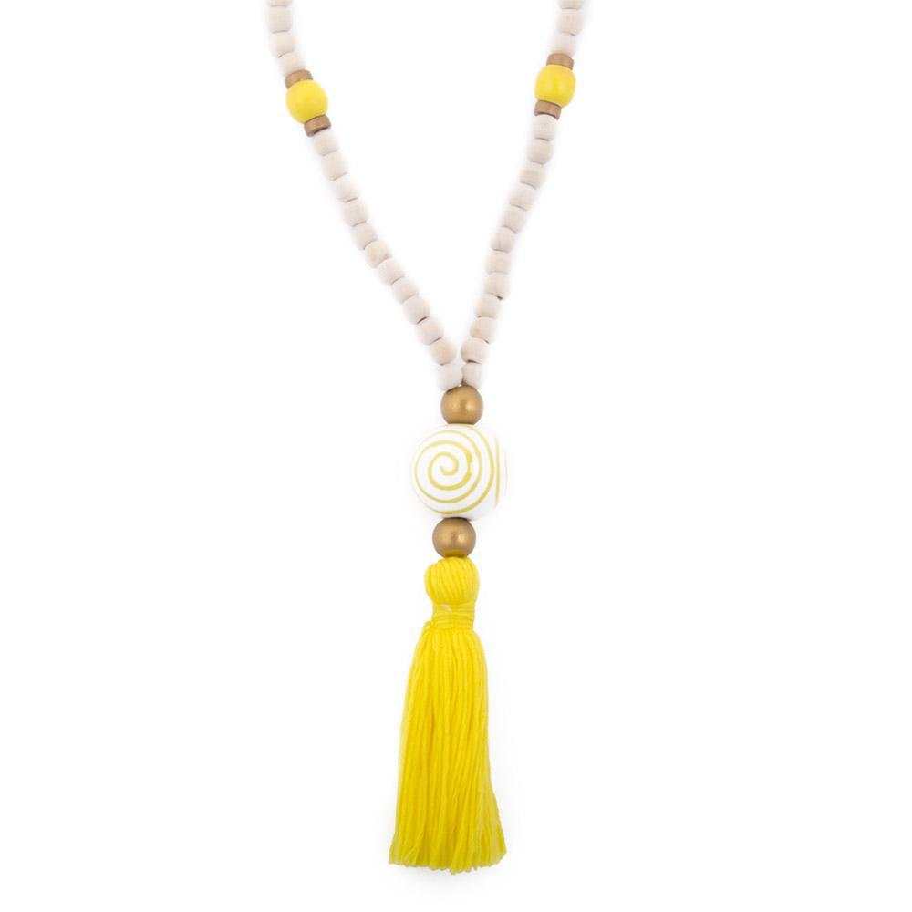 Natural wood bead necklace with yellow tassel featuring a large ceramic bead in the center