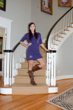 Model wearing a purple sleeve dress