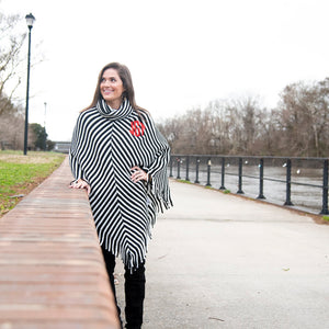 Lifestyle view of our Black Stripe Fringe Poncho