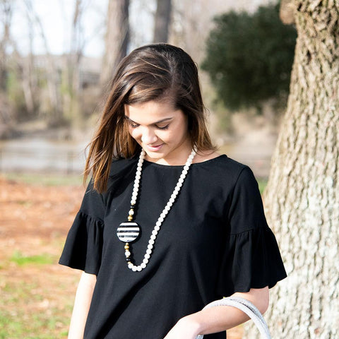 Lifestyle view of our Black Flat Bead Necklace