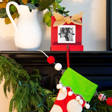 Load image into Gallery viewer, Lifestyle view of our Red Stocking Holder Frame