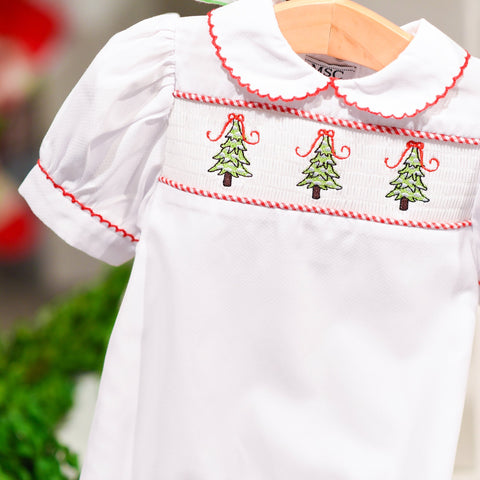 Lifestyle view of our Girl Christmas Tree Holiday Baby Smocked Day Gown