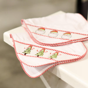 Lifestyle view of our Holiday Smocked Burp Cloths