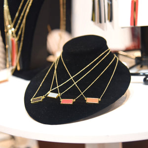 Lifestyle view of our Pebble Grain Rectangle Necklaces