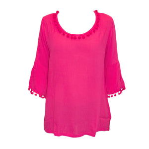 Front image of our Pink Pom Pom Shirt