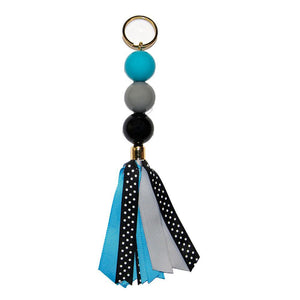 gray, light blue and black keychain