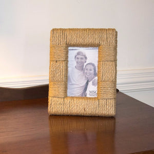 Rope portrait picture frame on a console table