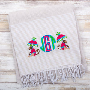 Lifestyle view of our Gray Stripe Fringe Beach Towel