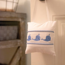 Lifestyle image of our Blue Whale Smocked Music Pillow
