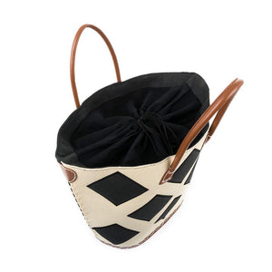 Top view of black diamond straw tote, showing the drawstring lining.