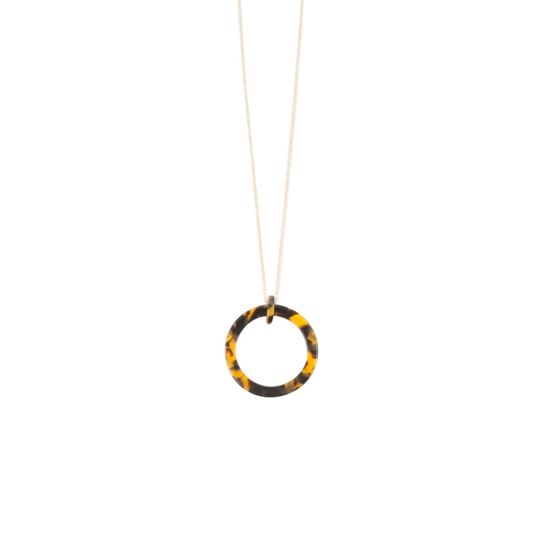 Front view of our Tortoise Circle Frame Necklace