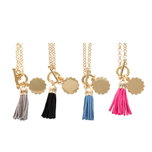 View of our Tassel Necklaces with Scallop Disc