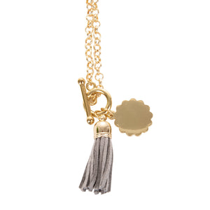 View of our Gray Tassel Necklace with Scallop Disc