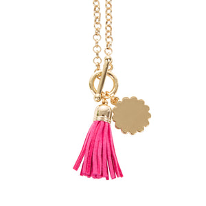 View of our Pink Tassel Necklace with Scallop Disc