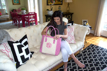 Young woman looking into her pink gingham tote bag at her living room