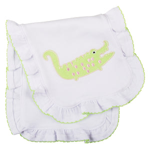 Folded burp cloth with ruffle trim featuring an alligator applique
