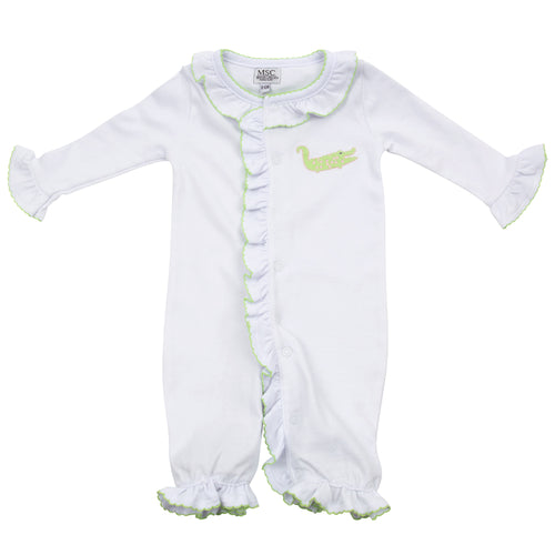 Baby onesie with an alligator applique on the left-hand side on the pocket area