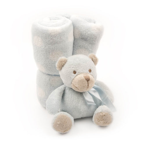 Wrapped plush blanket and plush bear tied with a bow