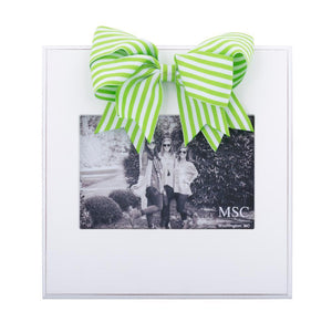 White frame with lime green and white stripe bow at the top of the frame, holds 4 x 6