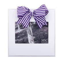White frame with purple and white stripe bow at the top of the frame, holds 4 x 6