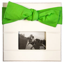 White picture frame with lime canvas bow