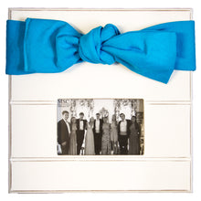 White picture frame with turquoise canvas bow