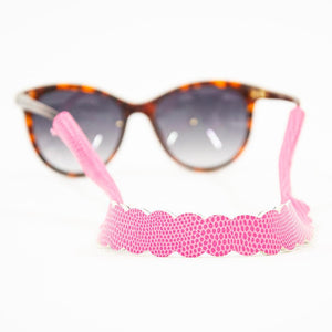 Lifestyle view of our Pink Lizard Scallop Sunglass Strap