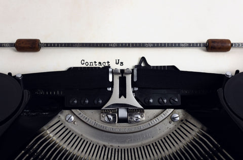 Typewriter with text saying contact us
