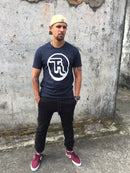 navy blue tee with whit logo print on front, black cuff pants. That_kiwi streetwear.